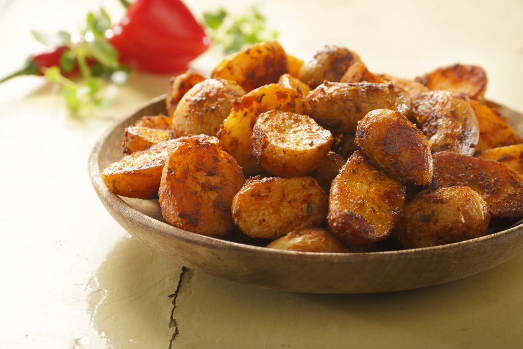 Peka potatoes mexican style are potato halves cooked and seasoned with spices.