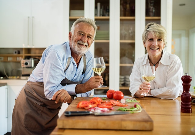 Retired couple cooking together on National Cooking Day